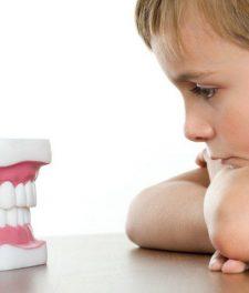 Ребенок скрипит зубами во сне: причины и лечение