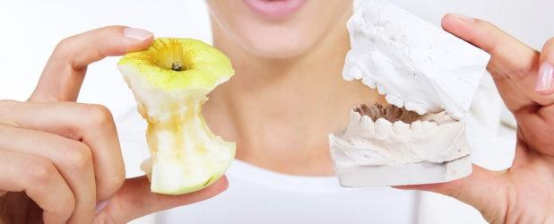 Как привыкнуть к съемным зубным протезам?